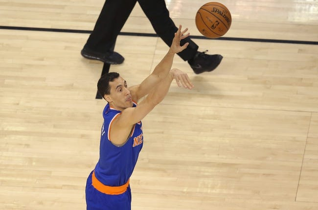 Apr 11, 2014; Toronto, Ontario, CAN; New York Knicks point guard Pablo Prigioni (9) hits a three-pointer against the Toronto Raptors at Air Canada Centre. Mandatory Credit: Tom Szczerbowski-USA TODAY Sports