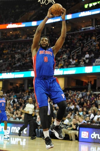 Apr 9, 2014; Cleveland, OH, USA; Detroit Pistons center Andre Drummond (0) rebounds against the Cleveland Cavaliers  at Quicken Loans Arena. Cleveland won 122-100. Mandatory Credit: David Richard-USA TODAY Sports