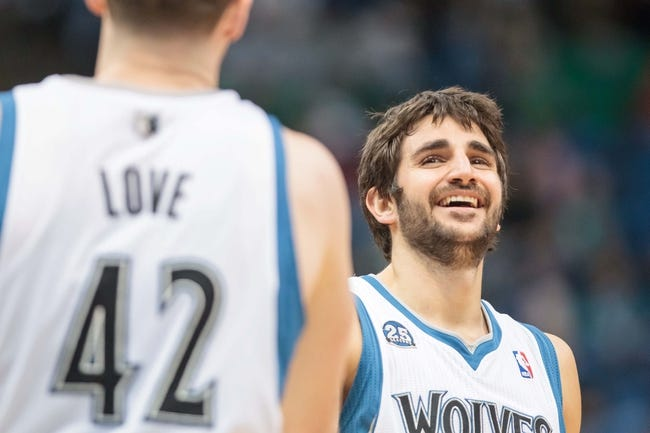 Apr 16, 2014; Minneapolis, MN, USA; Minnesota Timberwolves guard Ricky Rubio (9) smiles with forward Kevin Love (42) at Target Center. Mandatory Credit: Brad Rempel-USA TODAY Sports
