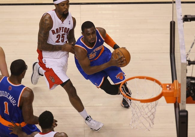 Apr 11, 2014; Toronto, Ontario, CAN; New York Knicks guard Tim Hardaway Jr. (5) goes to the basket against Toronto Raptors forward John Salmons (25) at Air Canada Centre. The Knicks beat the Raptors 108-100. Mandatory Credit: Tom Szczerbowski-USA TODAY Sports