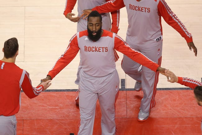 Apr 2, 2014; Toronto, Ontario, CAN; Houston Rockets guard James Harden (13) is introduced before the start of their game against the Toronto Raptors at Air Canada Centre. The Raptors beat the Rockets 107-103. Mandatory Credit: Tom Szczerbowski-USA TODAY Sports