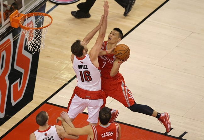 Apr 2, 2014; Toronto, Ontario, CAN; Houston Rockets guard Jeremy Lin (7) goes to the basket and scores against Toronto Raptors forward Steve Novak (16) at Air Canada Centre. The Raptors beat the Rockets 107-103. Mandatory Credit: Tom Szczerbowski-USA TODAY Sports