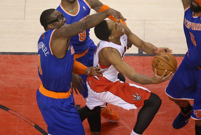 Apr 11, 2014; Toronto, Ontario, CAN; Toronto Raptors guard DeMar DeRozan (10) is fouled by New York Knicks forward Amar'e Stoudemire (1) as he goes to the basket at Air Canada Centre. The Knicks beat the Raptors 108-100. Mandatory Credit: Tom Szczerbowski-USA TODAY Sports