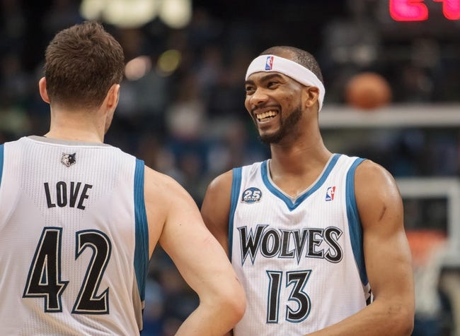 Apr 16, 2014; Minneapolis, MN, USA; Minnesota Timberwolves forward Corey Brewer (13) laughs with forward Kevin Love (42) at Target Center. Mandatory Credit: Brad Rempel-USA TODAY Sports