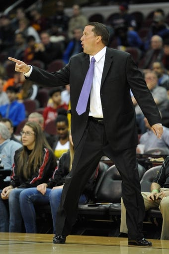 Apr 9, 2014; Cleveland, OH, USA; Detroit Pistons head coach John Loyer reacts against the Cleveland Cavaliers at Quicken Loans Arena. Cleveland won 122-100. Mandatory Credit: David Richard-USA TODAY Sports