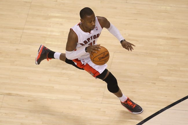Apr 2, 2014; Toronto, Ontario, CAN; Toronto Raptors guard Terrence Ross (31) dribbles against the Houston Rockets at Air Canada Centre. The Raptors beat the Rockets 107-103. Mandatory Credit: Tom Szczerbowski-USA TODAY Sports