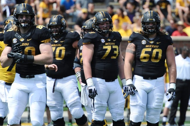 Apr 19, 2014; Columbia, MO, USA; Missouri Tigers tight end Sean Culkin (80) and offensive linesman Anthony Gatti (70) and offensive linesman Mitch Hall (73) and offensive linesman Connor McGovern (60) wait between plays during the Black & Gold Game at Faurot Field. Mandatory Credit: Dak Dillon-USA TODAY Sports