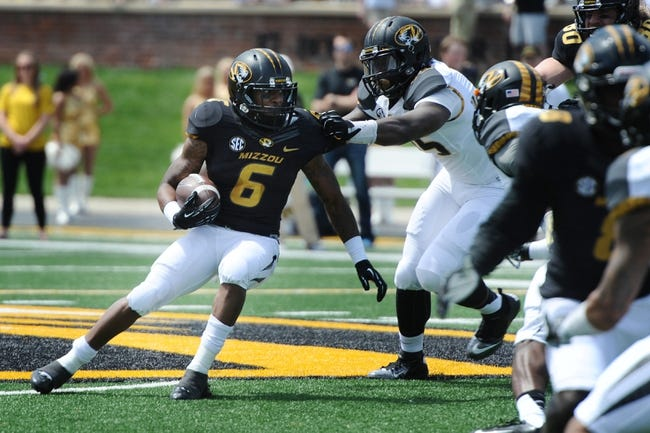 Apr 19, 2014; Columbia, MO, USA; Missouri Tigers running back Marcus Murphy (6) runs the ball as defensive lineman Marcus Loud (35) tries to stop him during the Black & Gold Game at Faurot Field. Mandatory Credit: Dak Dillon-USA TODAY Sports