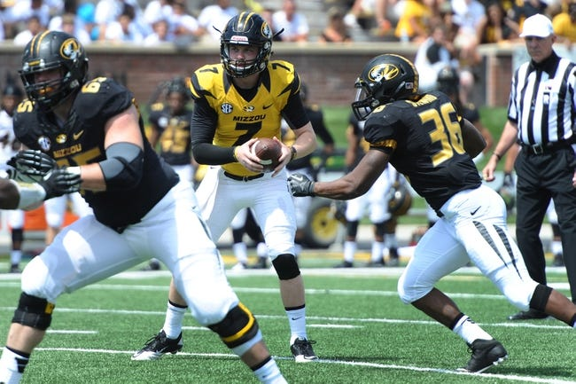 Apr 19, 2014; Columbia, MO, USA; Missouri Tigers quarterback Maty Mauk (7) hands off the ball to Missouri Tigers running back Morgan Steward (36) during the Black & Gold Game at Faurot Field. Mandatory Credit: Dak Dillon-USA TODAY Sports