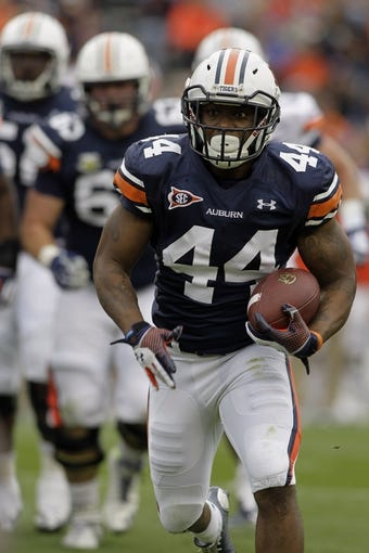 Apr 19, 2014; Auburn, AL, USA;  Auburn Tigers running back Cameron Artis-Payne (44) carries during the first half of the A-Day spring game at Jordan Hare Stadium. Mandatory Credit: John Reed-USA TODAY Sports