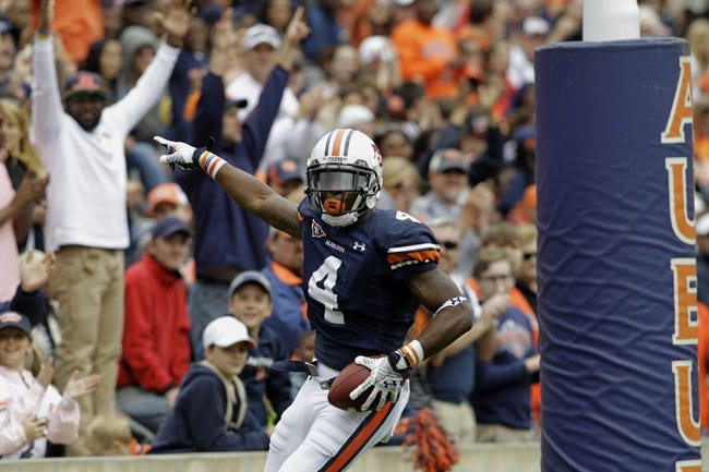 Apr 19, 2014; Auburn, AL, USA;  Auburn Tigers receiver Quan Bray (4) celebrates after scoring a touchdown during the first half of the A-Day spring game at Jordan Hare Stadium. Mandatory Credit: John Reed-USA TODAY Sports