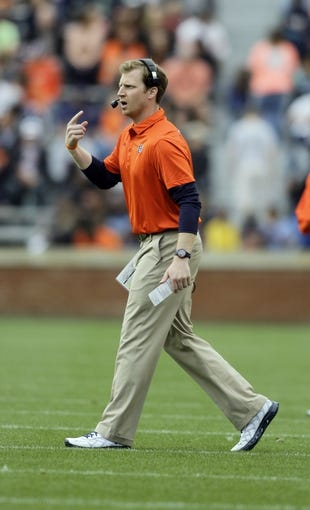 Apr 19, 2014; Auburn, AL, USA;  Auburn Tigers offensive coordinator Rhett Lashley calls a play during the first half of the A-Day spring game at Jordan Hare Stadium. Mandatory Credit: John Reed-USA TODAY Sports