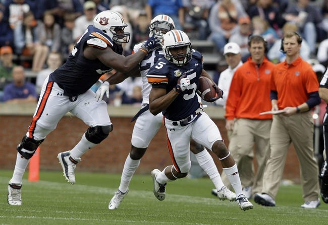 Apr 19, 2014; Auburn, AL, USA;  Auburn Tigers receiver Ricardo Louis (5) carries the ball during the first half of the A-Day spring game at Jordan Hare Stadium. Mandatory Credit: John Reed-USA TODAY Sports
