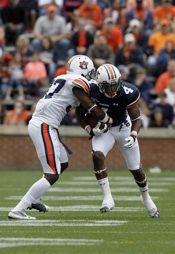 Apr 19, 2014; Auburn, AL, USA; Auburn Tigers receiver Quan Bray (4) is tackled by defensive back Kamry Melton (37) during the second half of the A-Day spring game at Jordan Hare Stadium. Mandatory Credit: John Reed-USA TODAY Sports
