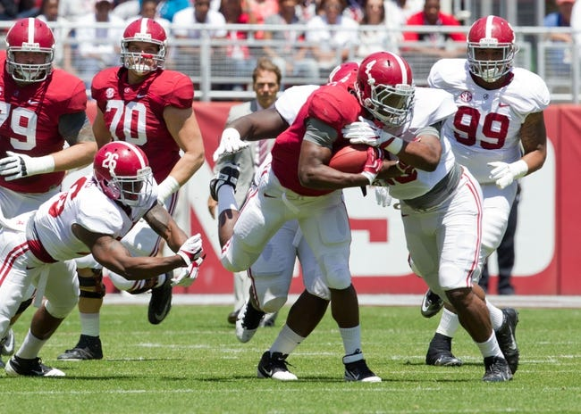 Apr 19, 2014; Tuscaloosa, AL, USA;  Alabama Crimson Tide running back T.J. Yeldon (4) carries the ball for the red team during the A-Day game at Bryant-Denny Stadium. Mandatory Credit: Marvin Gentry-USA TODAY Sports