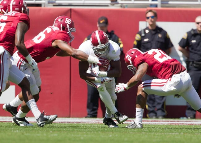 Apr 19, 2014; Tuscaloosa, AL, USA;  Alabama Crimson Tide running back Kenyan Drake (17) carries the ball during the A-Day game at Bryant-Denny Stadium. Mandatory Credit: Marvin Gentry-USA TODAY Sports