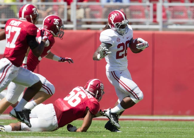 Apr 19, 2014; Tuscaloosa, AL, USA;  Alabama Crimson Tide  running back Altee Tenpenny (28) gets away from Alabama Crimson Tide  linebacker Tim Williams (56) at Bryant-Denny Stadium. Mandatory Credit: Marvin Gentry-USA TODAY Sports