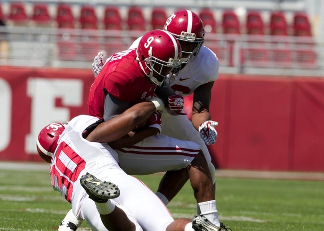 Apr 19, 2014; Tuscaloosa, AL, USA;  Alabama Crimson Tide  wide receiver Amari Cooper (9) is tackled by Alabama Crimson Tide linebacker Denzel Devall (30) and defensive back Landon Collins (26) at Bryant-Denny Stadium. Mandatory Credit: Marvin Gentry-USA TODAY Sports