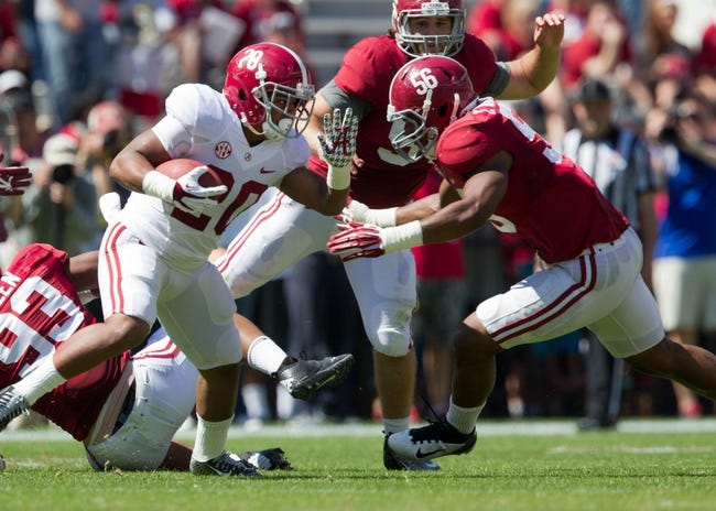 Apr 19, 2014; Tuscaloosa, AL, USA;  Alabama Crimson Tide running back Tyren Jones (20) carries the ball during the A-Day game at Bryant-Denny Stadium. Mandatory Credit: Marvin Gentry-USA TODAY Sports