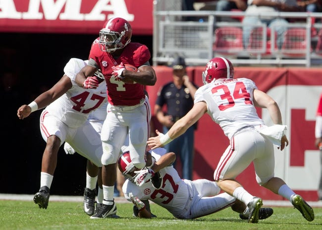 Apr 19, 2014; Tuscaloosa, AL, USA;  Alabama Crimson Tide running back T.J. Yeldon (4) is tackled from behind by Alabama Crimson Tide defensive back Zach Houston (37) at Bryant-Denny Stadium. Mandatory Credit: Marvin Gentry-USA TODAY Sports