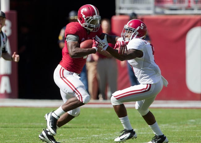Apr 19, 2014; Tuscaloosa, AL, USA;  Alabama Crimson Tide running back T.J. Yeldon (4) is grabbed Alabama Crimson Tide defensive back Cyrus Jones (5) at Bryant-Denny Stadium. Mandatory Credit: Marvin Gentry-USA TODAY Sports