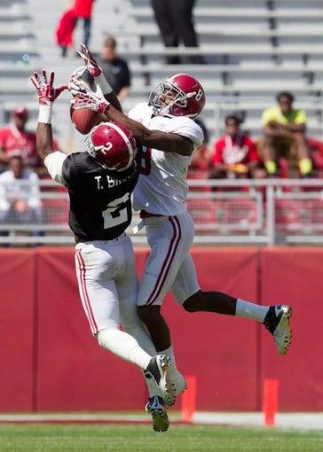 Apr 19, 2014; Tuscaloosa, AL, USA;  Alabama Crimson Tide defensive back Tony Brown (2) intercepts the ball from Alabama Crimson Tide wide receiver Robert Foster (8) during the A-Day game at Bryant-Denny Stadium. Mandatory Credit: Marvin Gentry-USA TODAY Sports