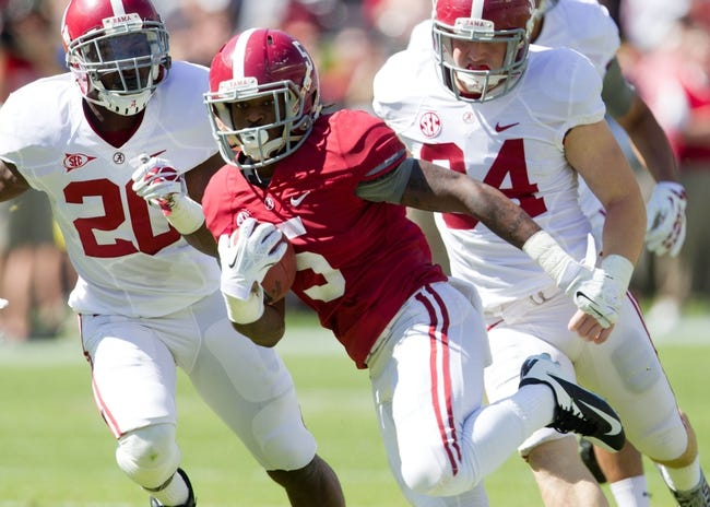 Apr 19, 2014; Tuscaloosa, AL, USA;  Alabama Crimson Tide wide receiver Chris Black (5) carries the ball for a touchdown during the A-Day game at Bryant-Denny Stadium. Mandatory Credit: Marvin Gentry-USA TODAY Sports