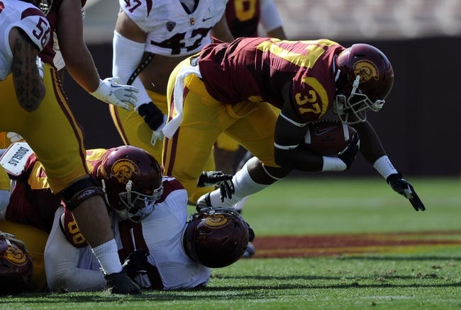 Apr 19, 2014; Los Angeles, CA, USA; Southern California tailback Javorius Allen (37) runs the ball tackled by Southern California defensive lineman Delvon Simmons (52) during the Southern California Spring Game at Los Angeles Memorial Coliseum. Mandatory Credit: Kelvin Kuo-USA TODAY Sports