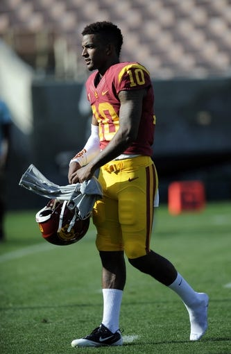 Apr 19, 2014; Los Angeles, CA, USA; Southern California quarterback Jalen Greene (10) walks off the field during the Southern California Spring Game at Los Angeles Memorial Coliseum. Mandatory Credit: Kelvin Kuo-USA TODAY Sports