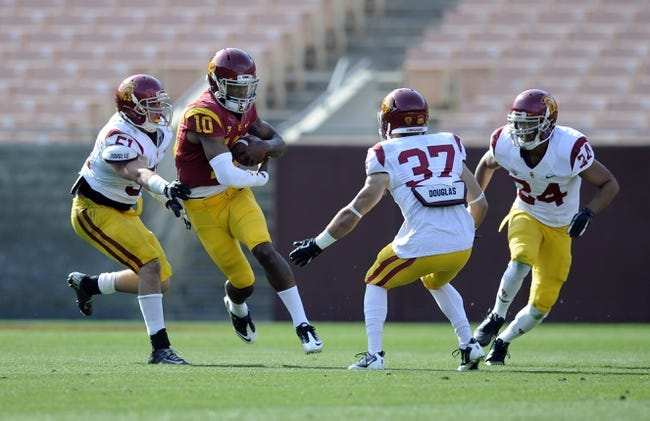 Apr 19, 2014; Los Angeles, CA, USA; Southern California quarterback Jalen Greene (10) moves the ball defended by Southern California inside linebacker Joel Foy (51) during the Southern California Spring Game at Los Angeles Memorial Coliseum. Mandatory Credit: Kelvin Kuo-USA TODAY Sports