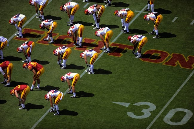 Apr 19, 2014; Los Angeles, CA, USA; Southern California warms up during the Southern California Spring Game at Los Angeles Memorial Coliseum. Mandatory Credit: Kelvin Kuo-USA TODAY Sports