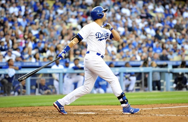 April 19, 2014; Los Angeles, CA, USA; Los Angeles Dodgers center fielder Andre Ethier (16) hits a three run home run in the fourth inning against the Arizona Diamondbacks at Dodger Stadium. Mandatory Credit: Gary Vasquez-USA TODAY Sports