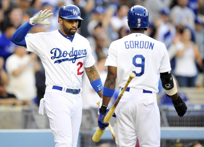 April 19, 2014; Los Angeles, CA, USA; Los Angeles Dodgers second baseman Dee Gordon (9) is greeted at home by center fielder Matt Kemp (27) after scoring a run in the fifth inning against the Arizona Diamondbacks at Dodger Stadium. Mandatory Credit: Gary Vasquez-USA TODAY Sports