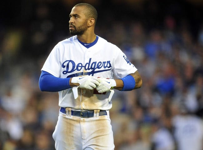 April 19, 2014; Los Angeles, CA, USA; Los Angeles Dodgers center fielder Matt Kemp (27) reacts after striking out in the seventh inning against the Arizona Diamondbacks at Dodger Stadium. Mandatory Credit: Gary Vasquez-USA TODAY Sports
