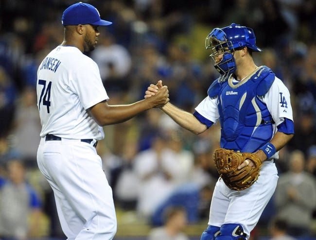 April 19, 2014; Los Angeles, CA, USA; Los Angeles Dodgers relief pitcher Kenley Jansen (74) and catcher Drew Butera (31) celebrate the 8-6 victory against the Arizona Diamondbacks at Dodger Stadium. Mandatory Credit: Gary Vasquez-USA TODAY Sports