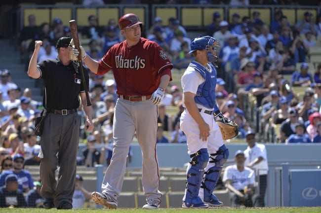 Apr 20, 2014; Los Angeles, CA, USA; Arizona Diamondbacks left fielder Mark Trumbo (15) reacts to striking out in the seventh inning against the Los Angeles Dodgers at Dodger Stadium. The Dodgers won 4-1. Mandatory Credit: Robert Hanashiro-USA TODAY Sports