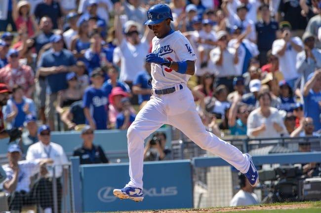 Apr 20, 2014; Los Angeles, CA, USA; Los Angeles Dodgers second baseman Dee Gordon (9) crosses home plate scoring in the sixth inning against the Arizona Diamondbacks at Dodger Stadium. Mandatory Credit: Robert Hanashiro-USA TODAY Sports