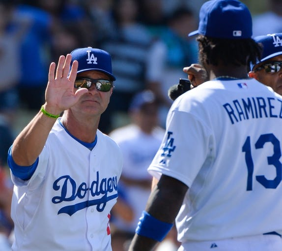 Apr 20, 2014; Los Angeles, CA, USA: Los Angeles Dodgers manager Don Mattingly celebrates with shortstop Hanley Ramirez (13) after defeating the Arizona Diamondbacks at Dodger Stadium. Mandatory Credit: Robert Hanashiro-USA TODAY Sports