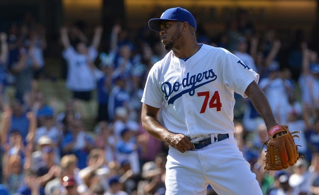 Apr 20, 2014; Los Angeles, CA, USA: Los Angeles Dodgers relief pitcher Kenley Jansen (74) reacts to striking out the side in the ninth inning of the Dodgers 4-1 win over Arizona Diamondbacks at Dodger Stadium. Mandatory Credit: Robert Hanashiro-USA TODAY Sports