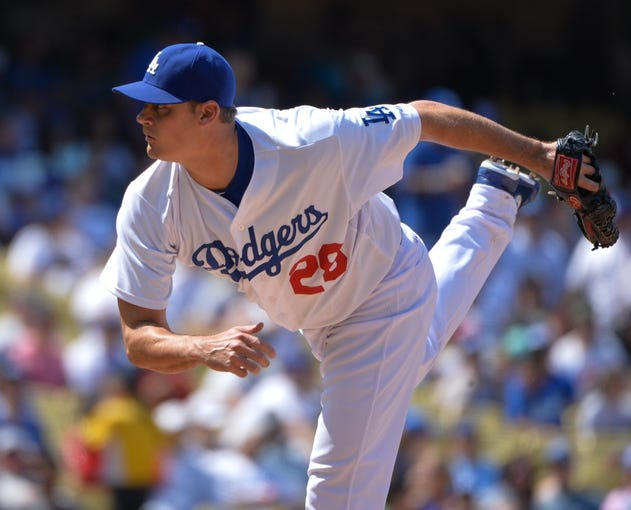 Apr 20, 2014; Los Angeles, CA, USA: Los Angeles Dodgers relief pitcher Jamey Wright (28) follows through on a pitch in the fith inning against the Arizona Diamondbacks at Dodger Stadium. Mandatory Credit: Robert Hanashiro-USA TODAY Sports