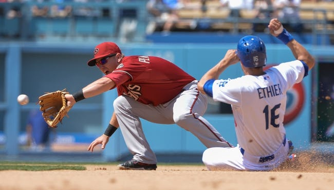 Apr 20, 2014; Los Angeles, CA, USA; Arizona Diamondbacks bench coach Alan Trammell (3) forces out Los Angeles Dodgers center fielder Andre Ethier (16) in the fith inning at Dodger Stadium. Mandatory Credit: Robert Hanashiro-USA TODAY Sports