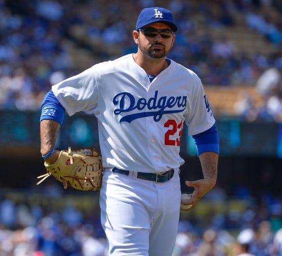 Apr 20, 2014; Los Angeles, CA, USA: Los Angeles Dodgers first baseman Adrian Gonzalez (23) looks on during the third inning against the Arizona Diamondbacks at Dodger Stadium. Mandatory Credit: Robert Hanashiro-USA TODAY Sports