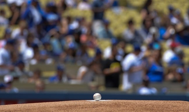 Apr 20, 2014; Los Angeles, CA, USA: The baseball rest on the pitching mound prior to the start of the first inning of the Arizona Diamondbacks and Los Angeles Dodgers game  at Dodger Stadium. Mandatory Credit: Robert Hanashiro-USA TODAY Sports