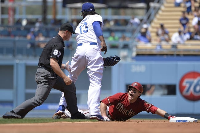 Apr 20, 2014; Los Angeles, CA, USA; Arizona Diamondbacks catcher Miguel Montero (26) expresses his displeasure on being called out by umpire Jeff Kellogg adoring the second inning at Dodger Stadium. Montero over slide second base and was tagged out by Los Angeles Dodgers shortstop Hanley Ramirez (13). Mandatory Credit: Robert Hanashiro-USA TODAY Sports
