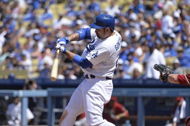 Apr 20, 2014; Los Angeles, CA, USA: Los Angeles Dodgers first baseman Adrian Gonzalez (23) swings the bat during the Dodgers 4-1 win over the Arizona Diamondbacks  at Dodger Stadium. Mandatory Credit: Robert Hanashiro-USA TODAY Sports