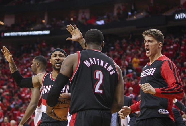 Apr 20, 2014; Houston, TX, USA; Portland Trail Blazers guard Mo Williams (25) celebrates with guard Wesley Matthews (2) and center Meyers Leonard (11) after defeating the Houston Rockets 122-120 in overtime in game one during the first round of the 2014 NBA Playoffs at Toyota Center. Mandatory Credit: Troy Taormina-USA TODAY Sports