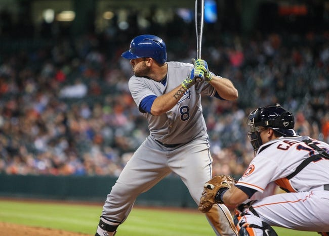 Apr 17, 2014; Houston, TX, USA; Kansas City Royals third baseman Mike Moustakas (8) bats during the fourth inning against the Houston Astros at Minute Maid Park. Mandatory Credit: Troy Taormina-USA TODAY Sports