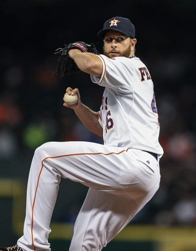 Apr 17, 2014; Houston, TX, USA; Houston Astros starting pitcher Scott Feldman (46) pitches during the fourth inning against the Kansas City Royals at Minute Maid Park. Mandatory Credit: Troy Taormina-USA TODAY Sports
