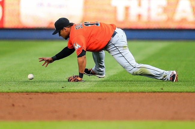 Apr 21, 2014; Atlanta, GA, USA; Miami Marlins second baseman Donovan Solano (17) fields a ground ball for an out in the second inning against the Atlanta Braves at Turner Field. Mandatory Credit: Daniel Shirey-USA TODAY Sports