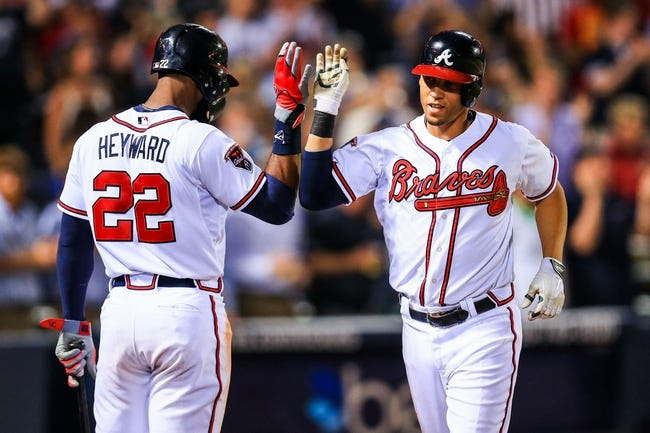 Apr 21, 2014; Atlanta, GA, USA; Atlanta Braves shortstop Andrelton Simmons (19) celebrates a solo home run with right fielder Jason Heyward (22) in the fifth inning against the Miami Marlins at Turner Field. Mandatory Credit: Daniel Shirey-USA TODAY Sports